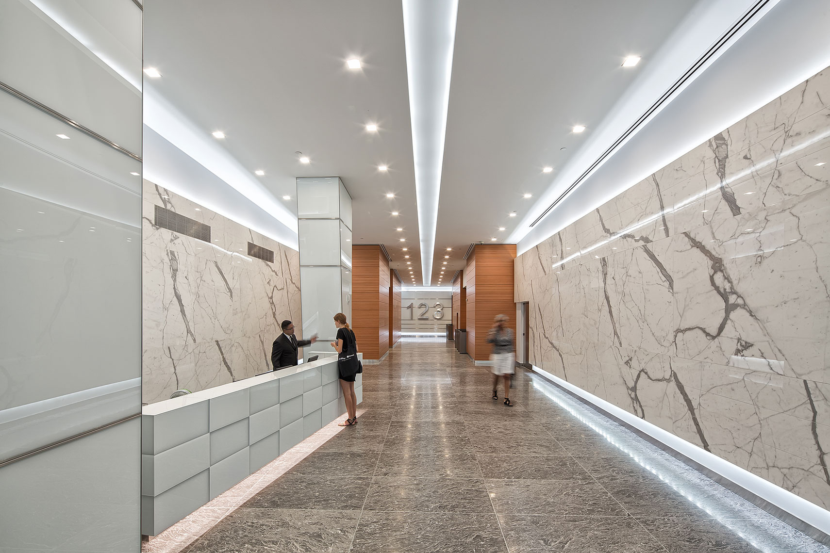 The stone work is stunning in this modern lobby. Architectural photographer NY.