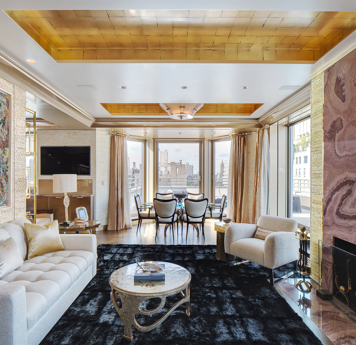 More gold! A custom cut mink area rug, and a vivid view of the east river.  Interior deign photographer