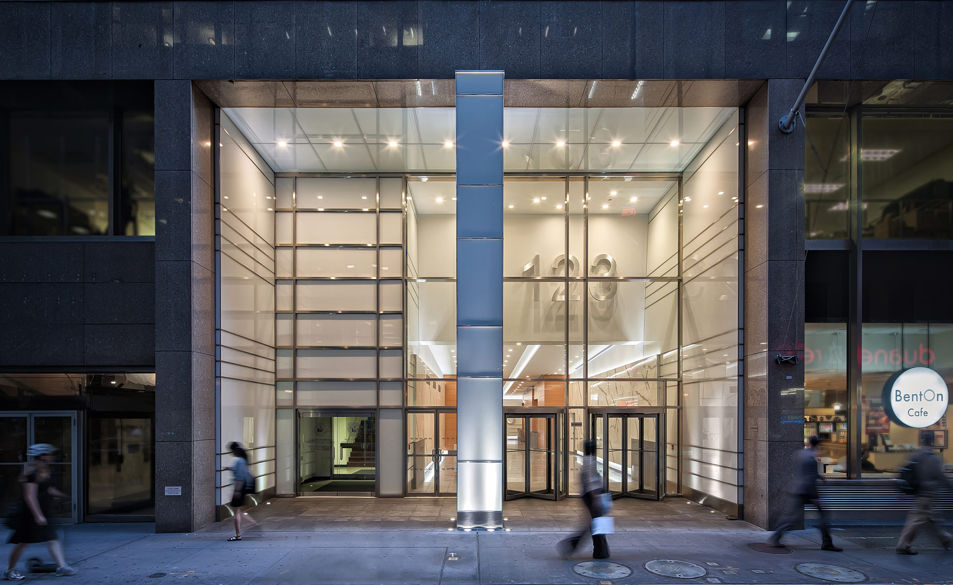 The hustle of rush hour in front of 123 William st NYC. Corporate interior photographer